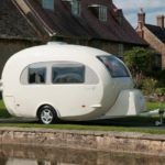 Caravan next to water